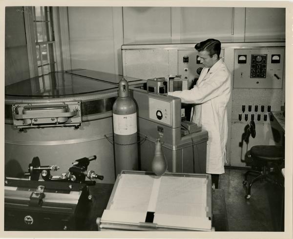 Medical staff using equipment