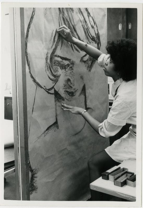 Art student, Marian Brown working with charcoal