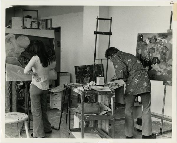 Two students painting in art class circa 1970s