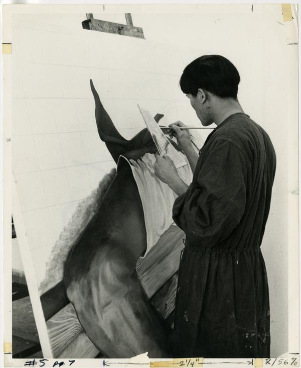 Art student painting on large canvas circa 1970s