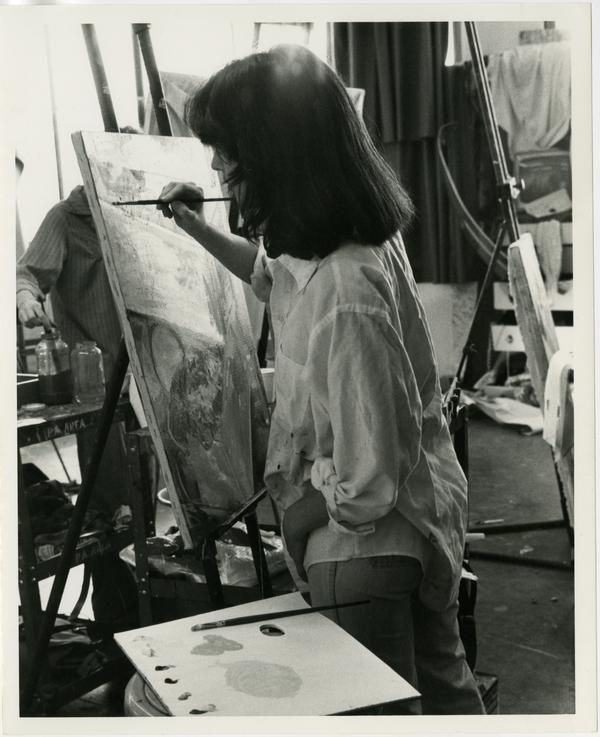 Art student painting in art class circa 1970s