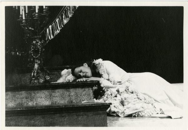 Actress performing a scene on stage during a play