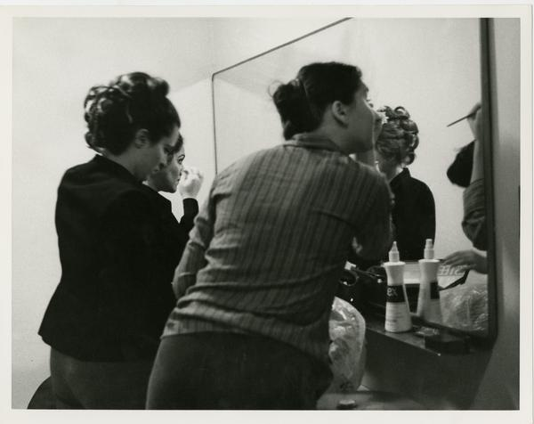 Actresses putting on make up in preparation for perfrming in Cosi Fan Tuttio Opera, 1978