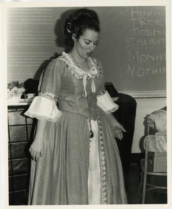 Actress examines her costume before performing in Cosi Fan Tutti Opera, 1978