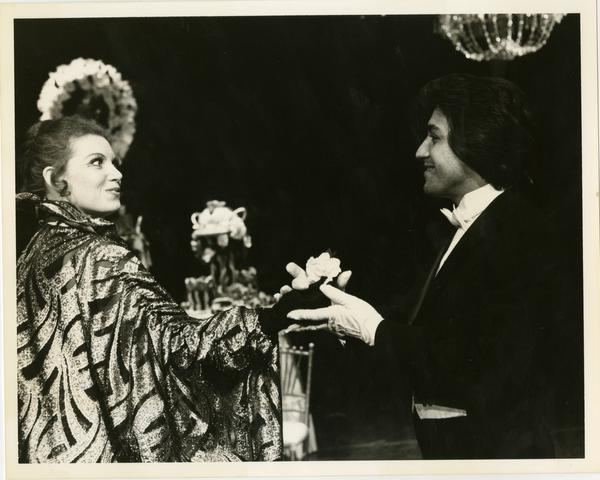 Two actors greet each other on stage while performing a scene from La Traviata Opera, 1979