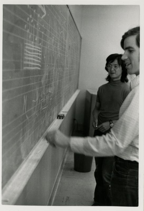 Students writing musical notes at a chalk board for composition class, 1972