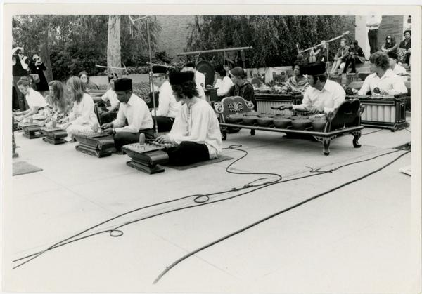 Side view of Javanese Gamelan performers on stage during the Ethno Spring Festival, c. 1970's