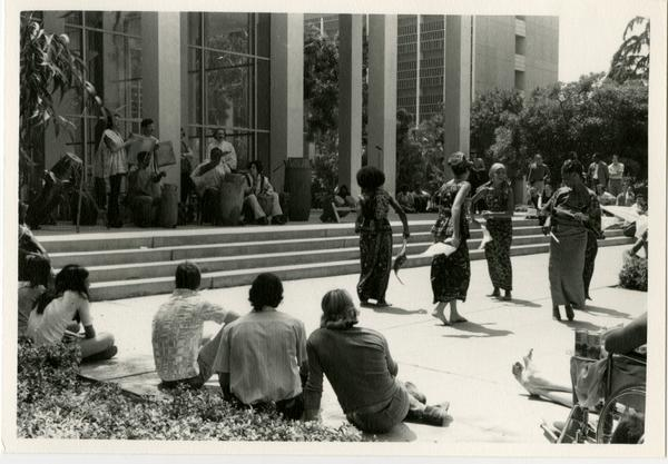 Women of the African Music and Dance Ensemble performing on stage during the Ethno Spring Music Festival, c. 1970's