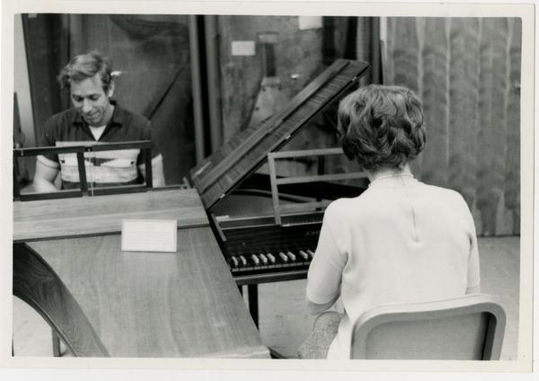 Man and woman playing on separate Harpischords