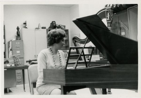 Woman playing a harpsichord