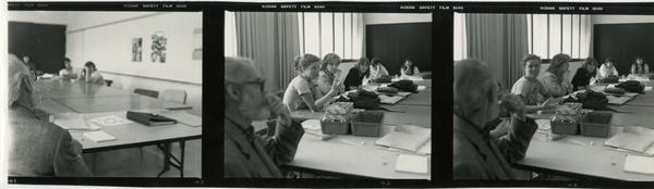 Various shots of Professor John Neuhard with students as they listen to thim lecture