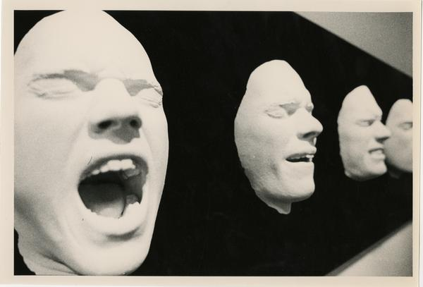 Casts of faces as part of an art exhibit