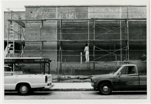 Construction worker working on the scaffolding of Schoenberg Hall