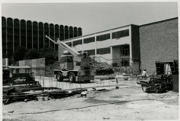 View of Schoenberg Hall construction site with equipment in the center