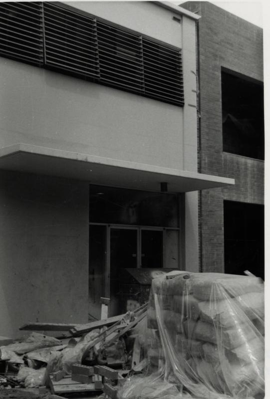 View of doorway with construction materials piled in the foreground
