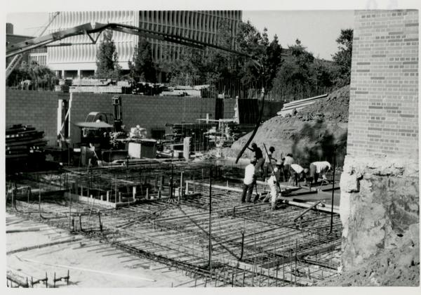 View of Schoenberg Hall construction site with construction workers at work