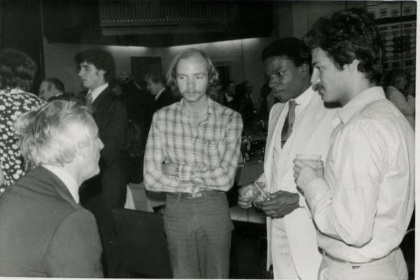Group of four men speaking at Goldwyn Reception, May 1981
