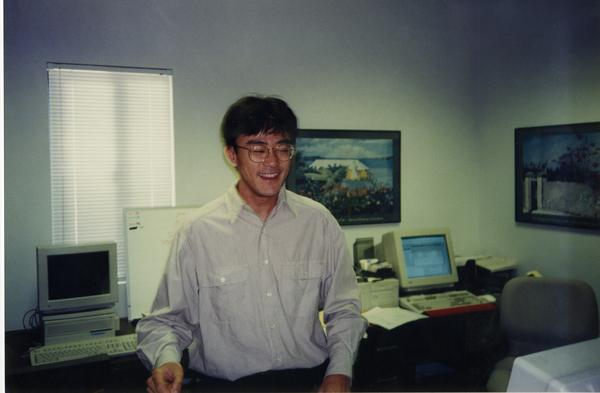 Member of Dean's OFC Staff standing in office