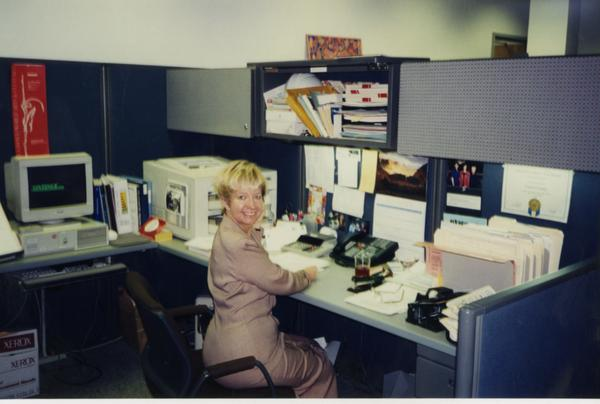 Member of Dean's OFC Staff sitting at computer