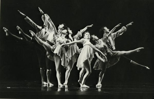 Dancers posing in formation on stage