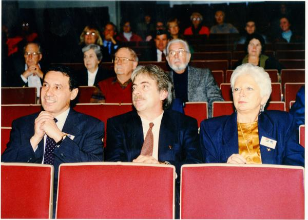 Enrica Banocchi at right, with two men sitting in the audience