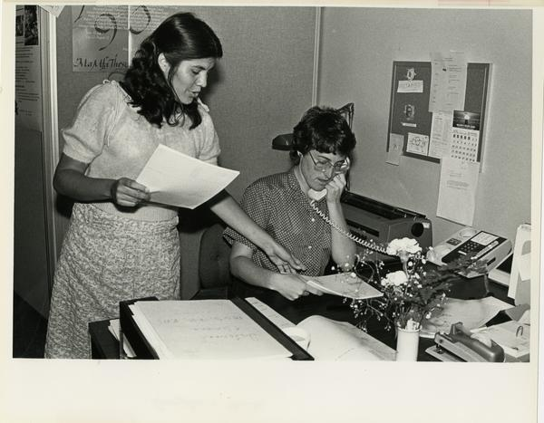 Two staff members at work in the Apollonian Society, a part of the School of Dentistry