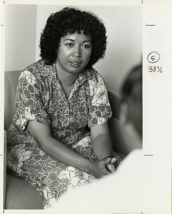 Elvira Quintos speaks to a client at the Asian Pacific Counseling Center (5/10/1984)