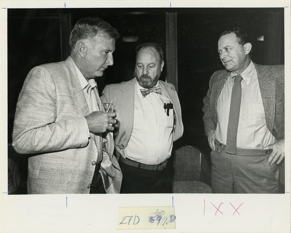 Class of 1956 reunion (1981); Bob Schumacher (left), George Mason (center), and unidentified male (right)