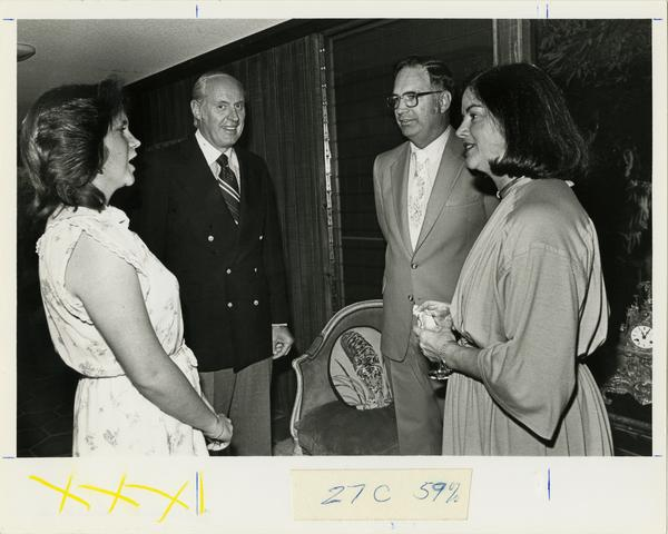 Harlan and Patti Amstutz greet Ralph Allison and unidentified woman at School of Medicine reunion