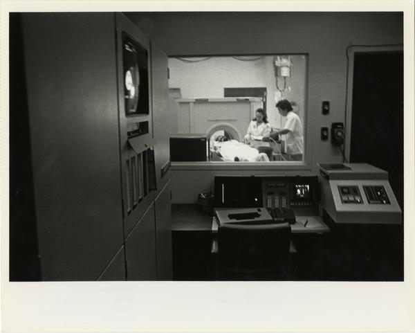 View of doctors setting up patient for the Computerized Tomography Simulater