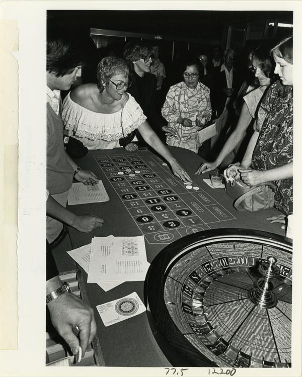 Group playing roulette at Dentistry Casino Night event, 1981