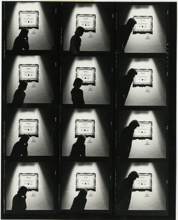 Contact sheet of woman looking at Dental Diploma, 1984