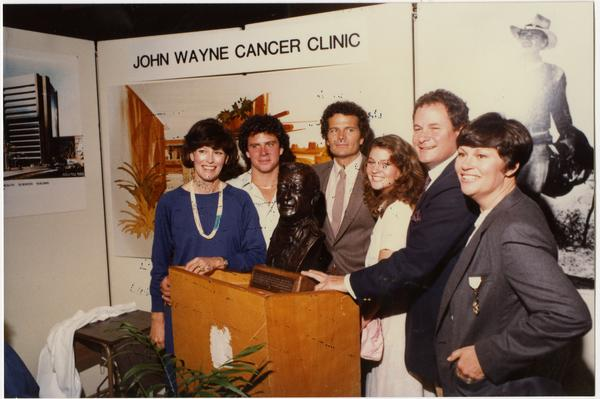 Michael, Patrick and Marisa Wayne pose with other family members at opening of John Wayne Cancer Clinic