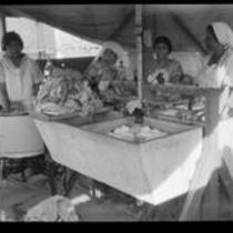 Women washing clothes in a tent laundry after the failure of the Saint Francis Dam and resulting flood, Santa Clara River Valley (Calif.), 1928