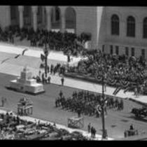 Parade passing Los Angeles City Hall during dedication ceremonies, 1928