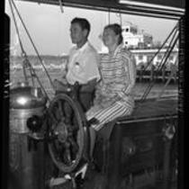 Errol Flynn and wife Nora Eddington Flynn on boat in Santa Monica, Calif., 1946