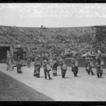 Hollenbeck Junior High School students in costume with float depicting California history, Shriners' parade, Los Angeles Memorial Coliseum, Los Angeles, 1925