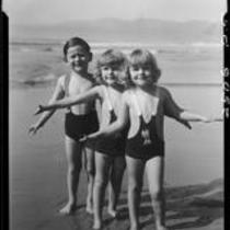 Patsy, Peggy, and Tommy Morgan posing on beach, Santa Monica, 1929