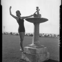 Woman posing next to fountain, Virginia Hotel, Long Beach, 1929