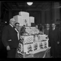 Harry Chandler and others with giant Los Angeles Times 50th Anniversary cake, 1931