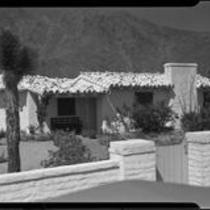 House with tiled roof, garden, and gated wall, Palm Springs, [1930s or 1940s?]