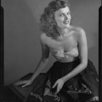 Miriam Braun, poses in skirt and strapless top, 1949
