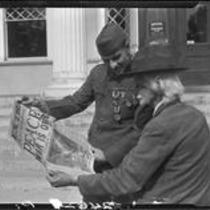Veterans Robert W. Renton and George L. Grimston with 1918 newspaper, Los Angeles, 1928 or 1930