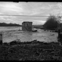 Flooded San Gabriel River in where eastern portion of El Monte bridge once stood in Los Angeles, Calif., 1921