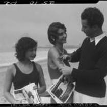 Silhouette artist Georges Boria and sunbathers Thelma Peairs and June Diebold, Venice, 1930