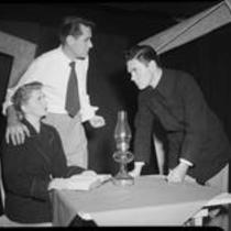 Two men and woman at small table, possibly acting in a play, [Santa Monica?], 1951