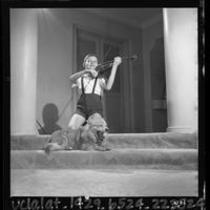 Violin prodigy Endre Balogh playing violin at his home in Los Angeles, Calif., 1964